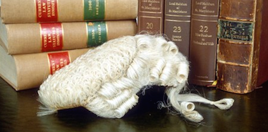 Barrister wig and law books